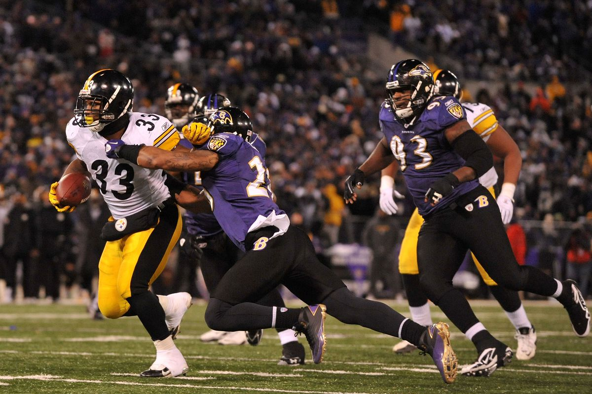 Isaac Redman breaks a tackle for a touchdown against the Ravens