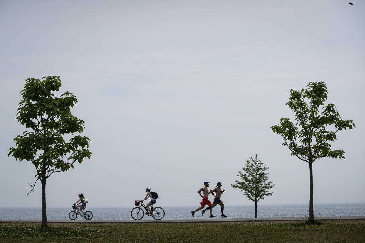 People exercise Monday on the Lakefront Trail near Fullerton Avenue.