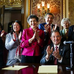Gov. Gary Herbert signs a concurrent resolution affirming Utah's support for the religious and civil liberties of immigrants and refugees during a ceremony at the Capitol in Salt Lake City on Monday, April 17, 2017.