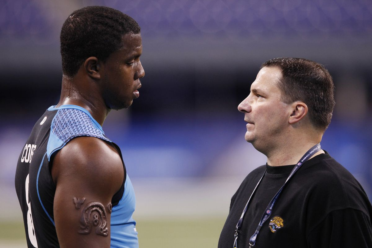 Joe Cullen (right) talks to DE Quinton Coples at the 2012 NFL Combine. Cullen has been hired as the Browns' new defensive line coach.