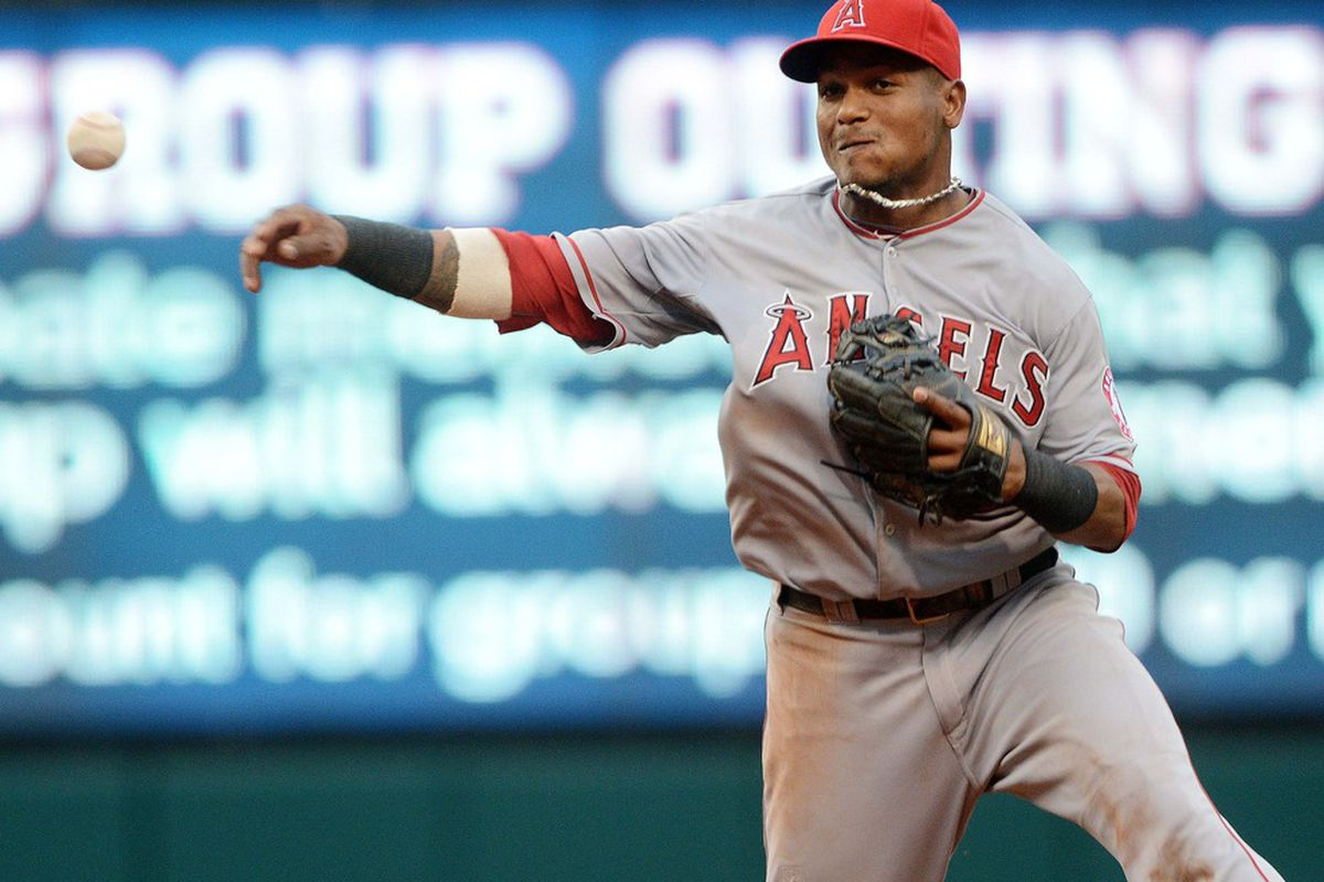 July 3, 2012; Cleveland, OH USA: Los Angeles Angels shortstop Erick Aybar (2) throws out a runner at first base during the game against the Cleveland Indians at Progressive Field.  Mandatory Credit: Eric P. Mull-USPRESSWIRE