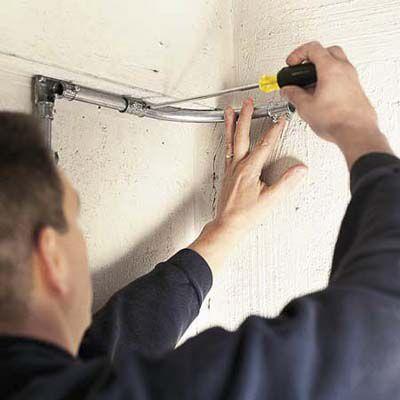 Man Installs Preformed Conduit Elbow
