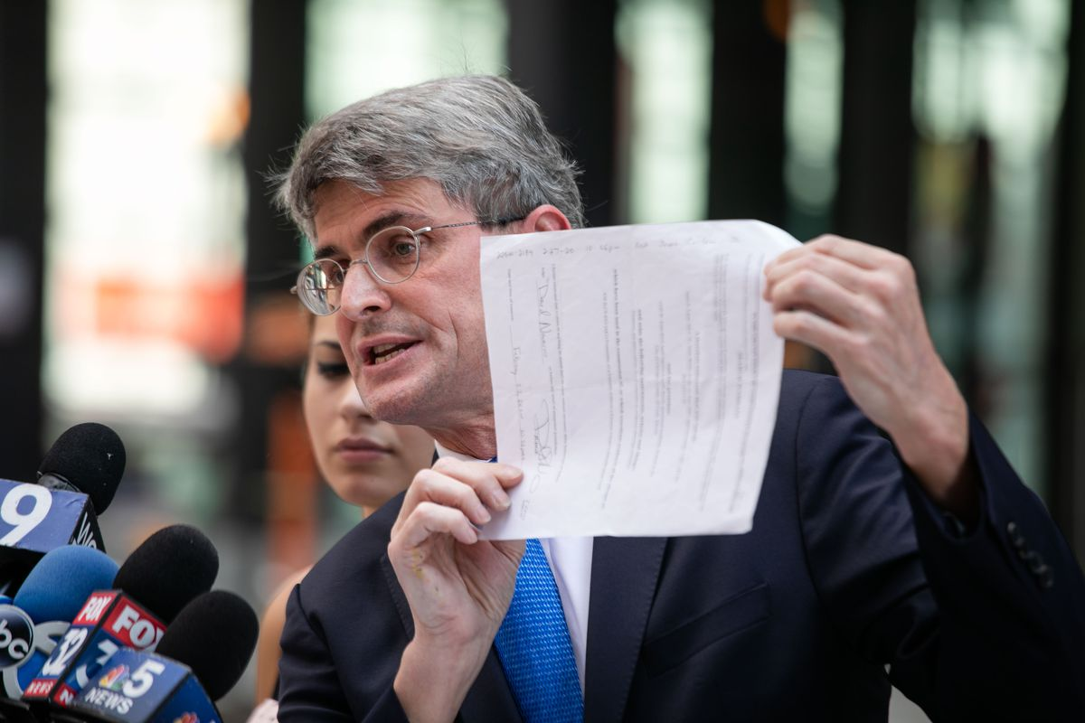 Al Hofeld Jr. represents Jasmine Vale in her lawsuit against the city of Chicago. He and Vale appeared at a news conference Thursday, Aug. 27, 2020, at which he displayed a search warrant with a missing signature. The lawsuit concerns a February raid by Chicago police. The lawsuit alleges 15 plainclothes officers with no body cameras burst into Vale's home and pointed their guns at her family, including her daughter and her daughter's grandmother.