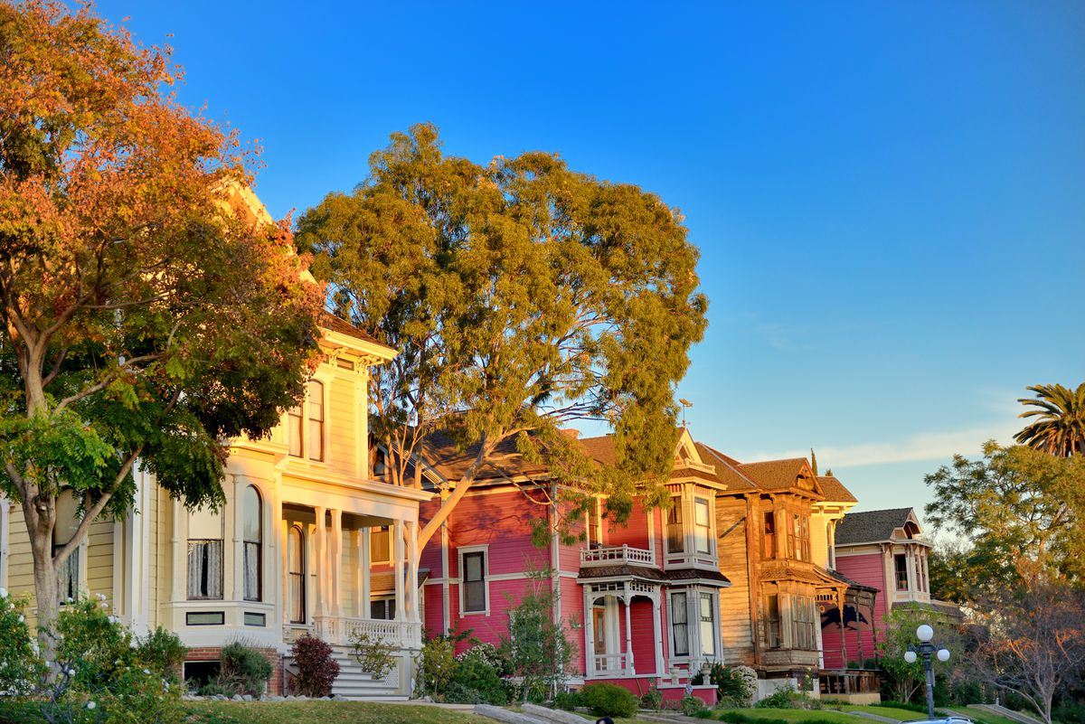 Rows of colorful Victorian houses on Carroll Avenue in Los Angeles.