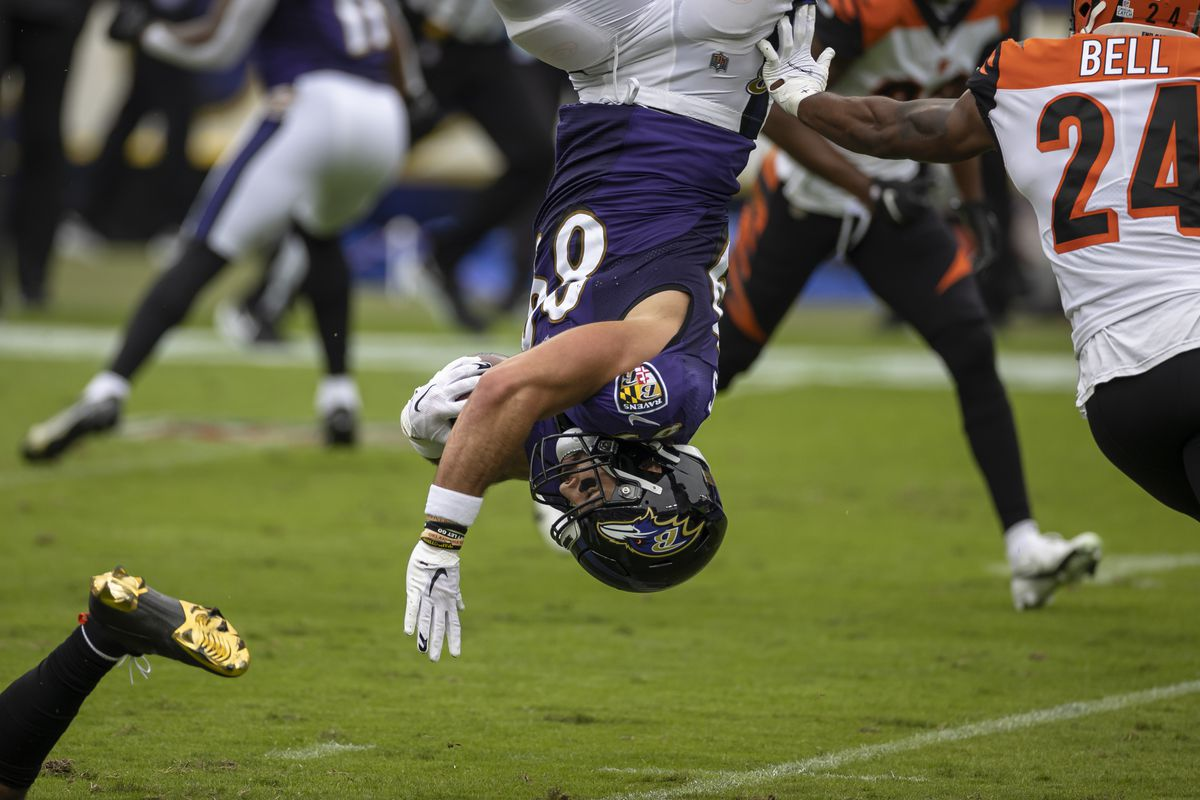 Mark Andrews #89 of the Baltimore Ravens is upended against the Cincinnati Bengals during the first half at M&T Bank Stadium on October 11, 2020 in Baltimore, Maryland.