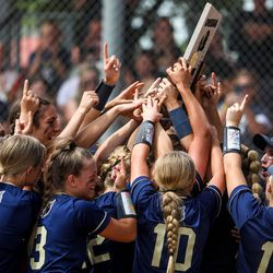 The Enterprise Wolves celebrate their win against the Beaver Beavers during a the 2A softball championship game at Spanish Fork Sports Park on Saturday, May 15, 2021. The Wolves won 5-2.
