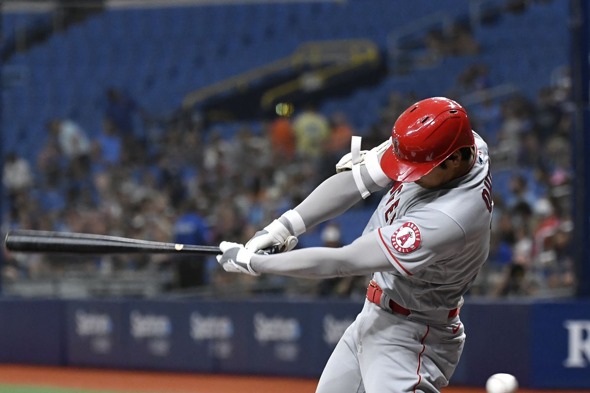 Shohei Ohtani #17 of the Los Angeles Angels swings at a pitch during the first inning against the Tampa Bay Rays at Tropicana Field on June 25, 2021 in St Petersburg, Florida.