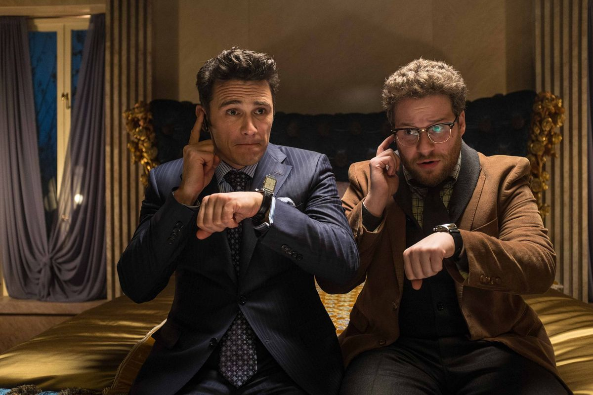 james franco and seth rogen check their ear pieces in the interview