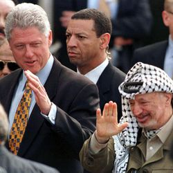 FILE - In this Monday, Dec. 14, 1998 file photo, Secret Service agents guard U.S. President Bill Clinton and Palestinian leader Yasser Arafat at the Gaza International Airport at Rafah. The Secret Service has been tarnished by a prostitution scandal that erupted April 13, 2012 in Colombia involving 12 Secret Service agents, officers and supervisors and 12 more enlisted military personnel ahead of President Barack Obama's visit there for the Summit of the Americas.