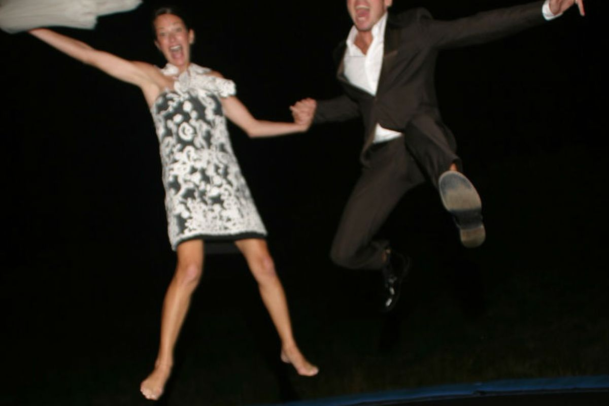 Cynthia Rowley and Bill Powers do a little post-wedding trampoline jumping