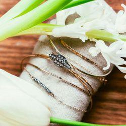 "Filigree cuff (center), <a href=""http://blancamonrosgomez.com/collections/bracelets/products/filigree-cuff"">$985</a>"