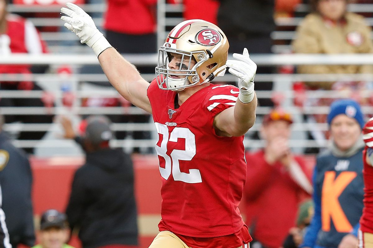 Ross Dwelley of the San Francisco 49ers pumps up the crowd after the team scored a touchdown in the fourth quarter against the Atlanta Falcons at Levi's Stadium on December 15, 2019 in Santa Clara, California.