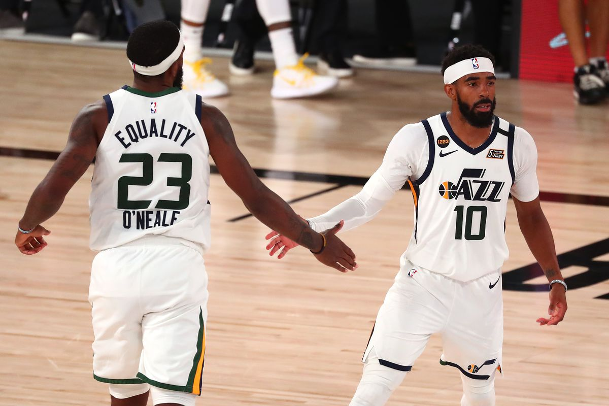 Utah Jazz guard Mike Conley (10) celebrates with forward Royce O'Neale (23) after making a three point basket against the Denver Nuggets during the second half of game seven of the first round of the 2020 NBA Playoffs at ESPN Wide World of Sports Complex.