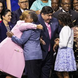 Mayor-elect Lori Lightfoot, her wife Amy Eshleman and their daughter Vivian greet Gov. J.B. Pritzker and his wife, M.K. Pritzker, before Lightfoot takes her oath of office during the city of Chicago's inauguration ceremony at Wintrust Arena, Monday morning, May 20, 2019.