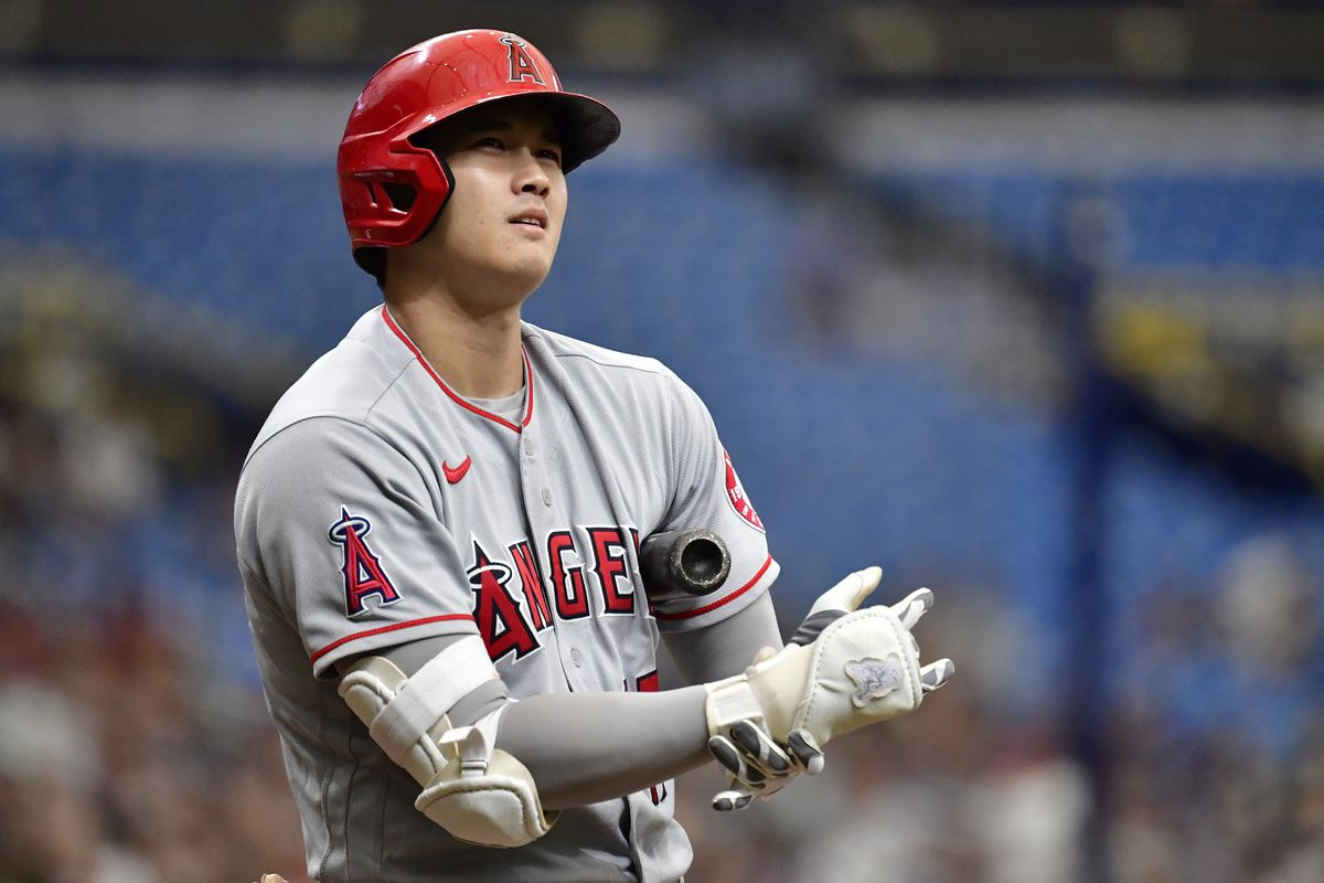 Shohei Ohtani of the Los Angeles Angels looks on during the first inning against the Tampa Bay Rays at Tropicana Field on June 27, 2021 in St Petersburg, Florida.