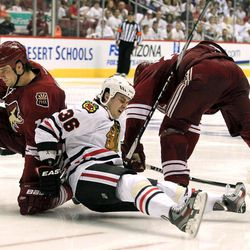 Chicago Blackhawks' Dave Bolland (36) gets upended by Phoenix Coyotes' Rostislav Klesla, left, of the Czech Republic, and Michal Rozsival, right, of the Czech Republic, during the second period in Game 1 of an NHL hockey Stanley Cup first-round playoff series, Thursday, April 12, 2012, in Glendale, Ariz.