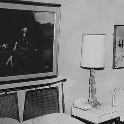This Nov. 22, 1963 photo provided by Amon Carter Museum of American Art Archives shows the paintings Thomas Eakins', Swimming and Charles M. Russell's, Lost in a Snowstorm in Suite 850 at the Hotel Texas, in Fort Worth, Texas. An exhibit opening next year at the Dallas Museum of Art will feature almost all of the works of art gathered from museums and prominent Fort Worth citizens for the hotel suite John F. Kennedy and first lady Jacqueline Kennedy stayed in the night before he was assassinated.