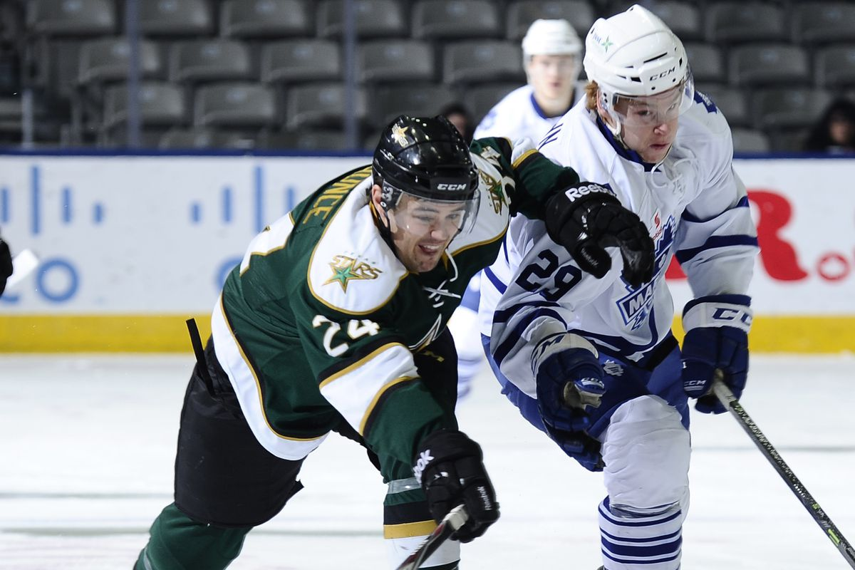 Cameron Gaunce works to win a puck in Toronto.