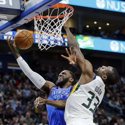 Oklahoma City Thunder forward Patrick Patterson shoots as Utah Jazz center Ekpe Udoh is called for a foul during NBA basketball in Salt Lake City on Saturday, Dec. 23, 2017.