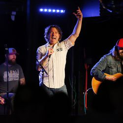 Neal Middleton, lead singer of the Royal Bliss and co-owner of The Royal in Murray, raises his arm during a song as the band plays on Friday, May 22, 2020 at the Royal.