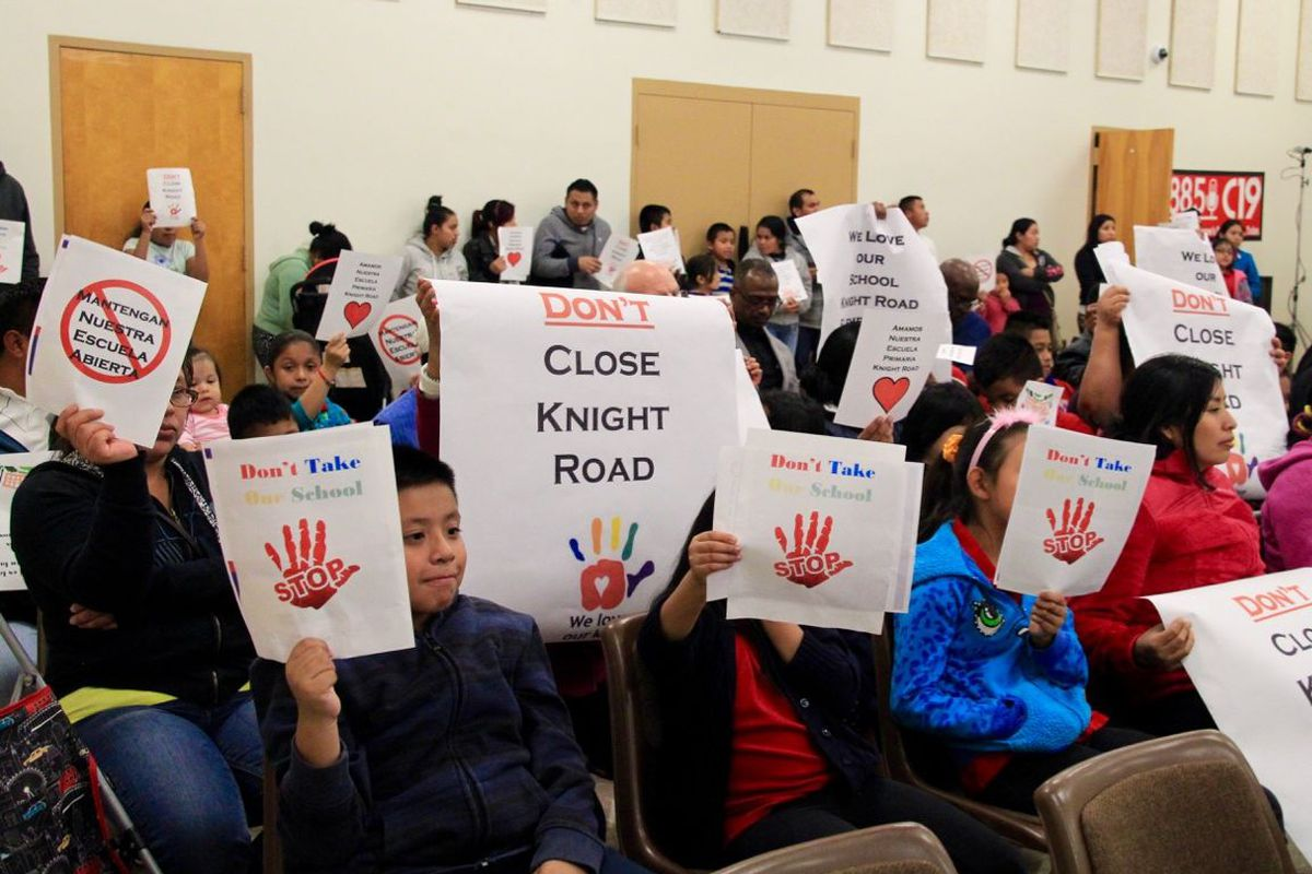 Parents and students from Knight Road Elementary School protest a proposal that would shutter their school during a board meeting for Shelby County Schools.
