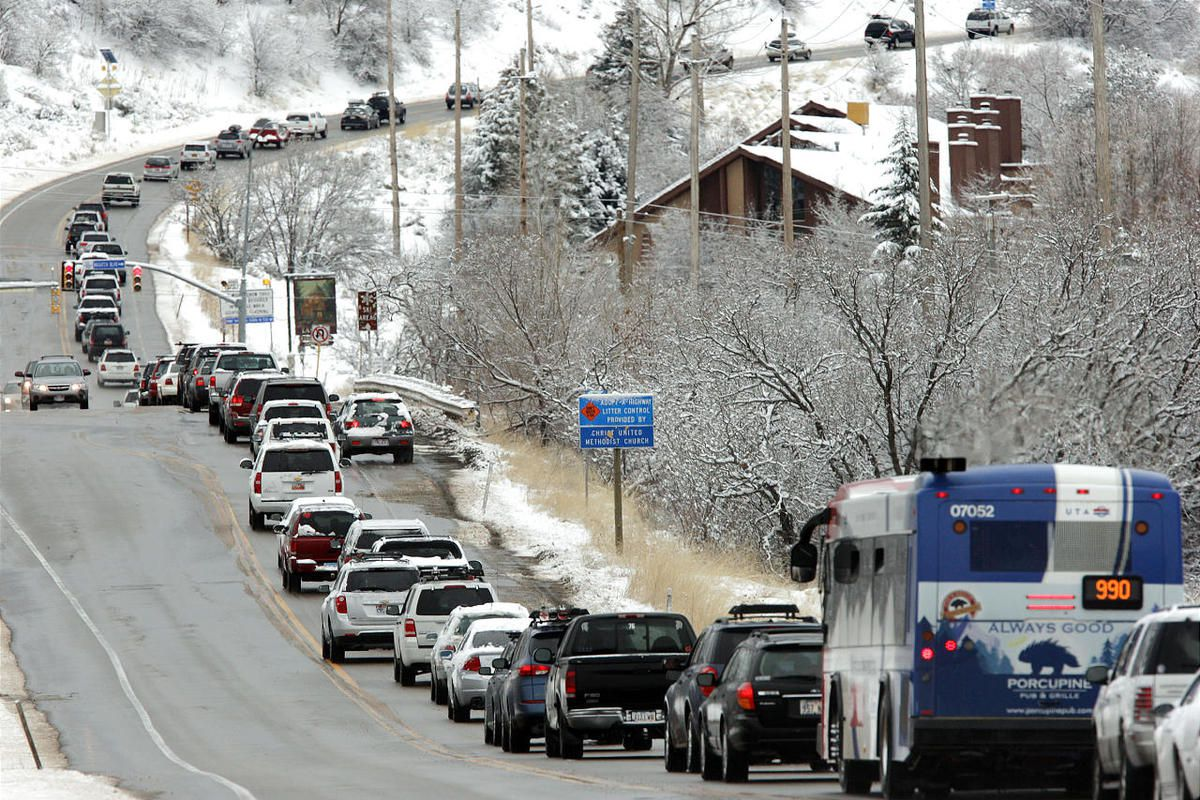 Traffic is heavy Sunday morning along Wasatch Drive near Little Cottonwood Canyon as skiers and boarders head to the slopes.