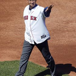 Former Boston Red Sox manager Terry Francona walks onto the field during ceremonies to celebrate the 100th anniversary of the first regular season baseball game at Fenway Park, before a game between the New York Yankees and the Red Sox in Boston, Friday, April 20, 2012.