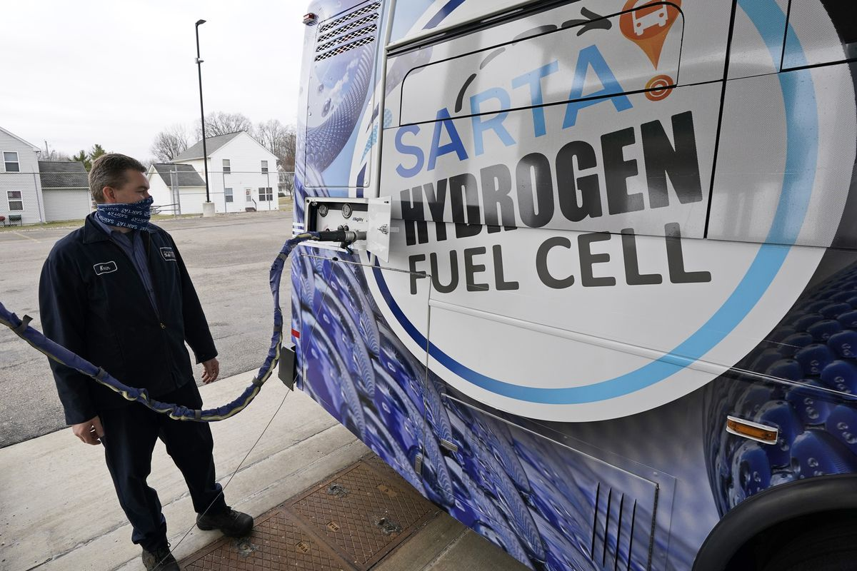 Kevin Baker, a maintenance technician, refuels a hydrogen fuel cell bus in Canton, Ohio.