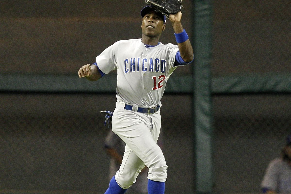 Alfonso Soriano of the Chicago Cubs makes a catch on a fly ball by Matt Dominguez of the Houston Astros at Minute Maid Park in Houston, Texas. (Photo by Bob Levey/Getty Images)