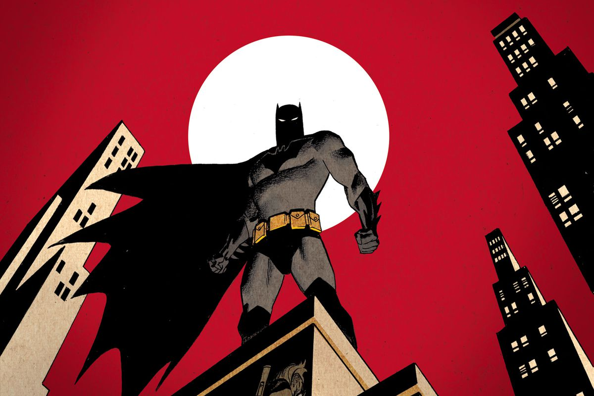 Batman stands on top of a building in Gotham with the faces of his numerous villains in the building below him