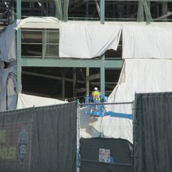 Tarp being replaced on the northwest corner of the ballpark -