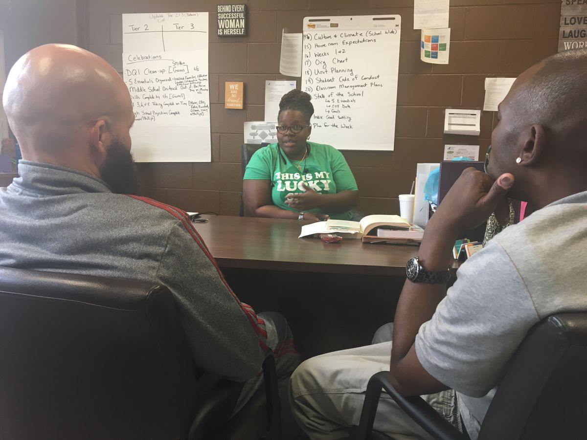 """Tareef Michael (left) and Oliver """"Power"""" Grant (right) talk with King Academy Principal Jasmine Thurmond.   provided photo"""