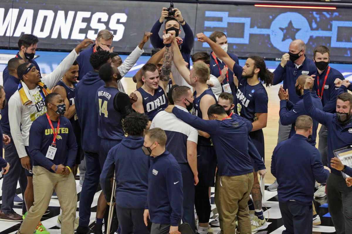 Oral Roberts Golden Eagles link arms and bow their heads following their win over Ohio State Buckeyes in overtime during the first round of the 2021 NCAA Tournament on Friday, March 19, 2021, at Mackey Arena in West Lafayette, Ind.