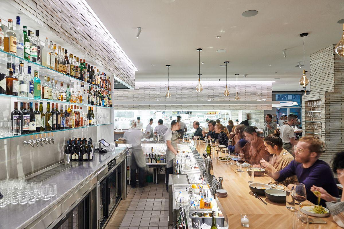 Patrons dine at the bar at Misi