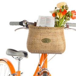 """Planning on a pit stop at Grand Park for some mid-ride picnicking? This sweet vintage-inspired bike basket will keep your snacks from getting squished. <b>Nantucket</b> Lightship bike basket, $50 at <a href=""""http://publicbikes.com/p/Nantucket-Lightship-Bi"""