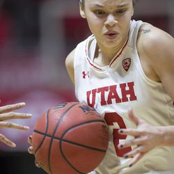 Utah Utes guard Tori Williams (2) takes the ball down the court during the Utes' 84-68 loss to the Oregon Ducks at the Jon M. Huntsman Center in Salt Lake City on Sunday, Jan. 28, 2018.