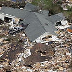An aerial view shows homes in Waveland, Miss., that were destroyed by Hurricane Katrina as it passed through the area on Monday.