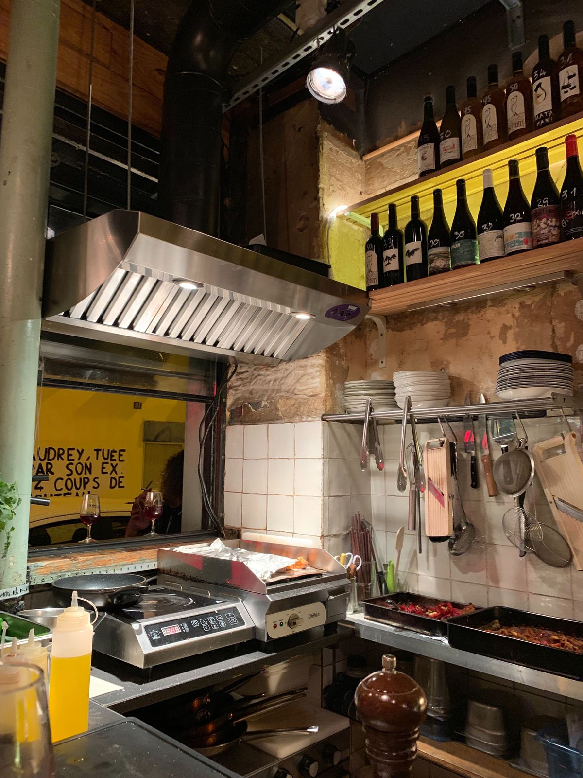 The small kitchen of a wine bar in Paris.