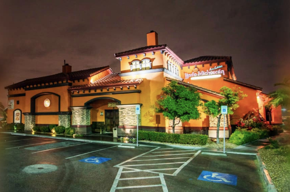 A view of a Mexican restaurant at night