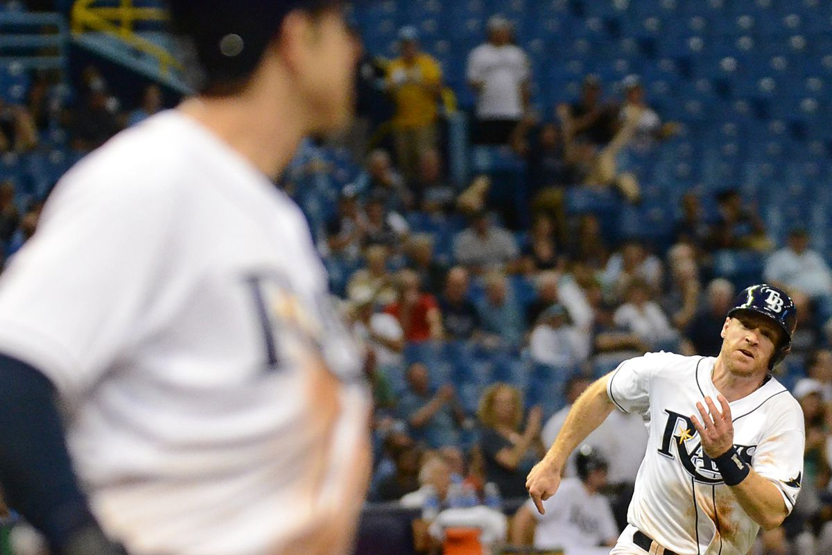 Rays second baseman Logan Forsythe (11) heads for home in the seventh inning against the New York Yankees at Tropicana Field.
