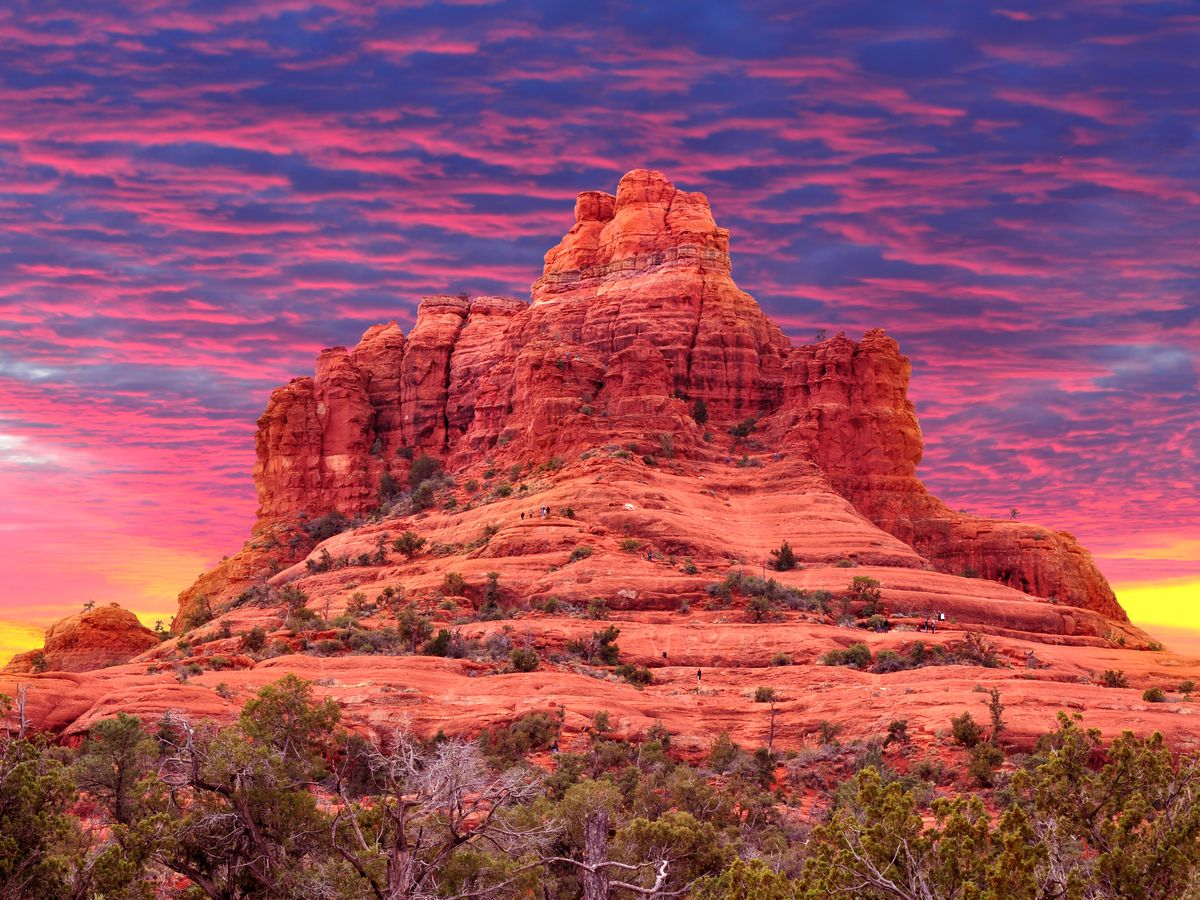A stunning red rock formation at sunset