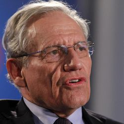 """This June 11, 2012 file photo shows former Washington Post reporter Bob Woodward speaking during an event to commemorate the 40th anniversary of Watergate in Washington. The next book by the award-winning investigative reporter and best-selling author will document how President Barack Obama and congressional leaders responded to the economic crisis and where we stand now. """"The Price of Politics"""" and will come out Sept. 11."""