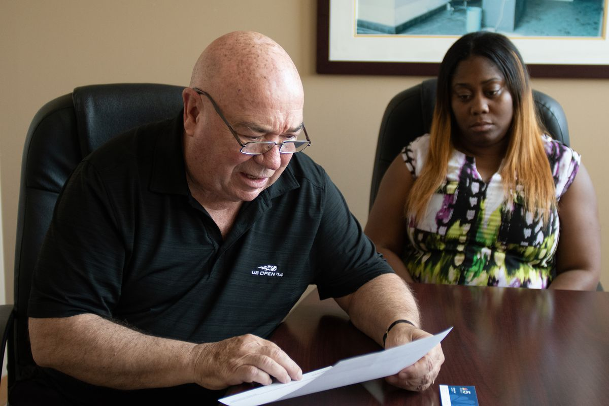 Ron Gatton looks over an open work order from tenant Carla Mosley at St. Edmunds Village Apartments on June 28, 2018. | Colin Boyle/Sun-Times