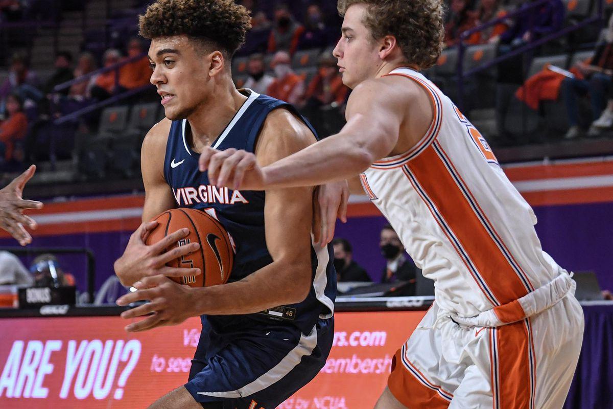 Virginia Cavaliers forward Justin McKoy drives against Clemson Tigers forward O'Neil McBride during the second half at Littlejohn Coliseum.
