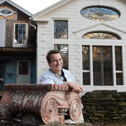 """In this photo taken Feb. 1, 2012, Bronson Pinchot poses for photos near the rear facade of the Decker House, one of six properties he owns in Harford, Pa.  Pinchot, best known for his starring role on the 1980's sitcom """"Perfect Strangers,"""" is back on TV with a new show about restoring his historic Pennsylvania homes. The show, """"The Bronson Pinchot Project,"""" premiered this month on the DIY cable network."""