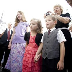 Onnika and Caleb Christensen hold hands as they watch the cornerstone ceremony. About 200 took part in the ceremony at the Brigham City Temple prior to the dedication Sunday, Sept. 23, 2012.