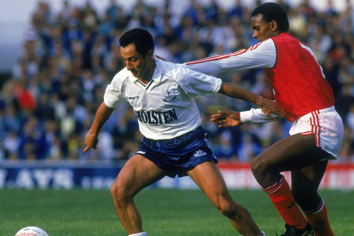 Ossie Ardiles of Tottenham Hotspur and David Rocastle of Arsenal