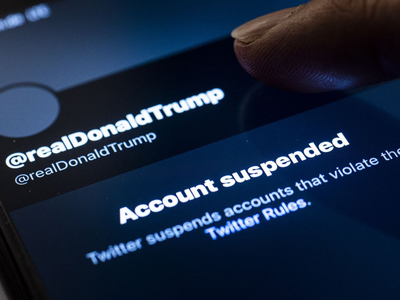 "Image of a screen showing Trump's Twitter account and an ""account suspended"" notification."