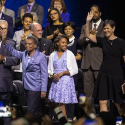 Mayor-elect Lori Lightfoot, her wife Amy Eshleman and their daughter Vivian walk on stage before Lightfoot takes her oath of office during the city of Chicago's inauguration ceremony at Wintrust Arena, Monday morning, May 20, 2019.