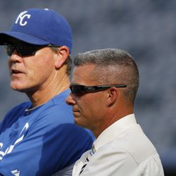 General Manager Dayton Moore and Manager Ned Yost of the Kansas City Royals watch batting practice during a game against the Detroit Tigers at Kauffman Stadium on August 5, 2011 in Kansas City, Missouri.